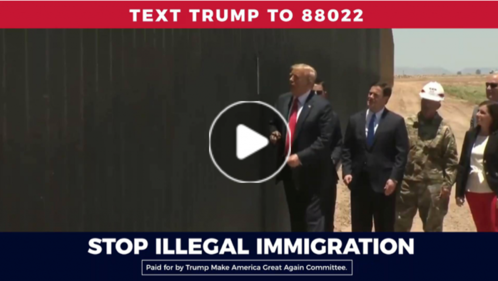 """Paused video from a Trump ad. The scene shows President Trump and four other individuals inspecting the border wall. Above the scene is the following statement: """"TEXT TRUMP TO 88022."""" Below the scene is the following statement: """"STOP ILLEGAL IMMIGRATION."""""""