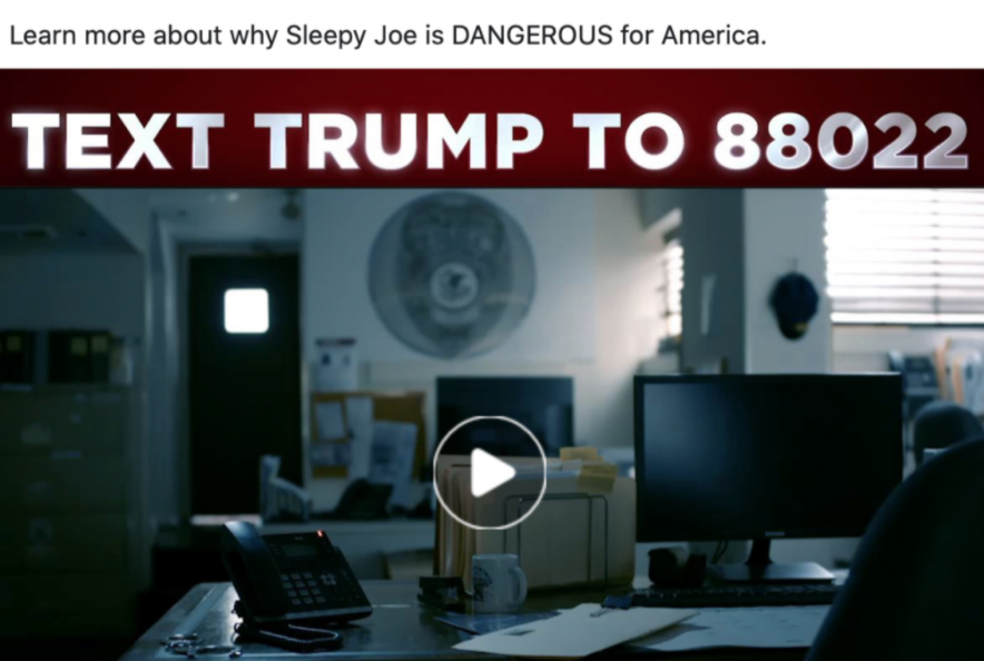 """Paused video from a Trump ad. The scene shows a dark police station office with the following statement"""" Learn more about why Sleepy Joe is DANGEROUS for America. TEXT TRUMP TO 88022."""""""