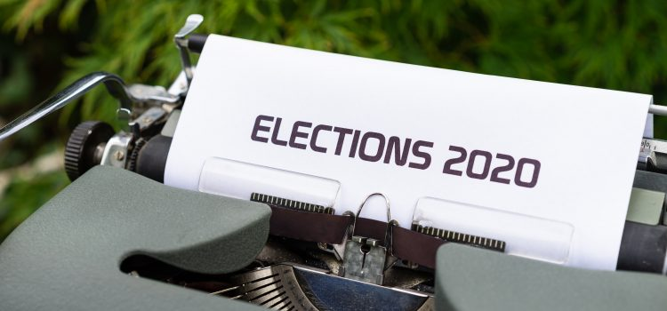 """Typewriter with """"ELECTIONS 2020"""" already typed out on the paper."""