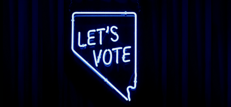 """A light fixture in the shape of the state of Nevada with """"LET'S VOTE"""" inside the state."""